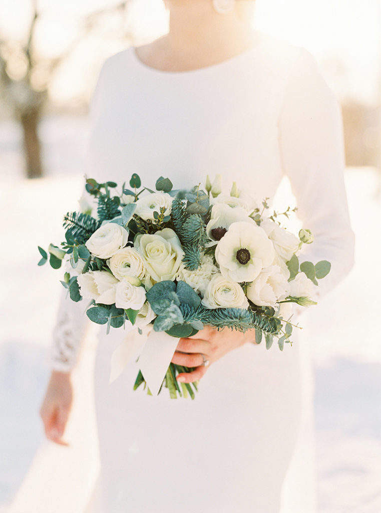 White bridal bouquet with anemones