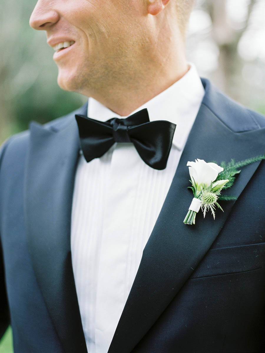 Grooms details bow tie and buttonire