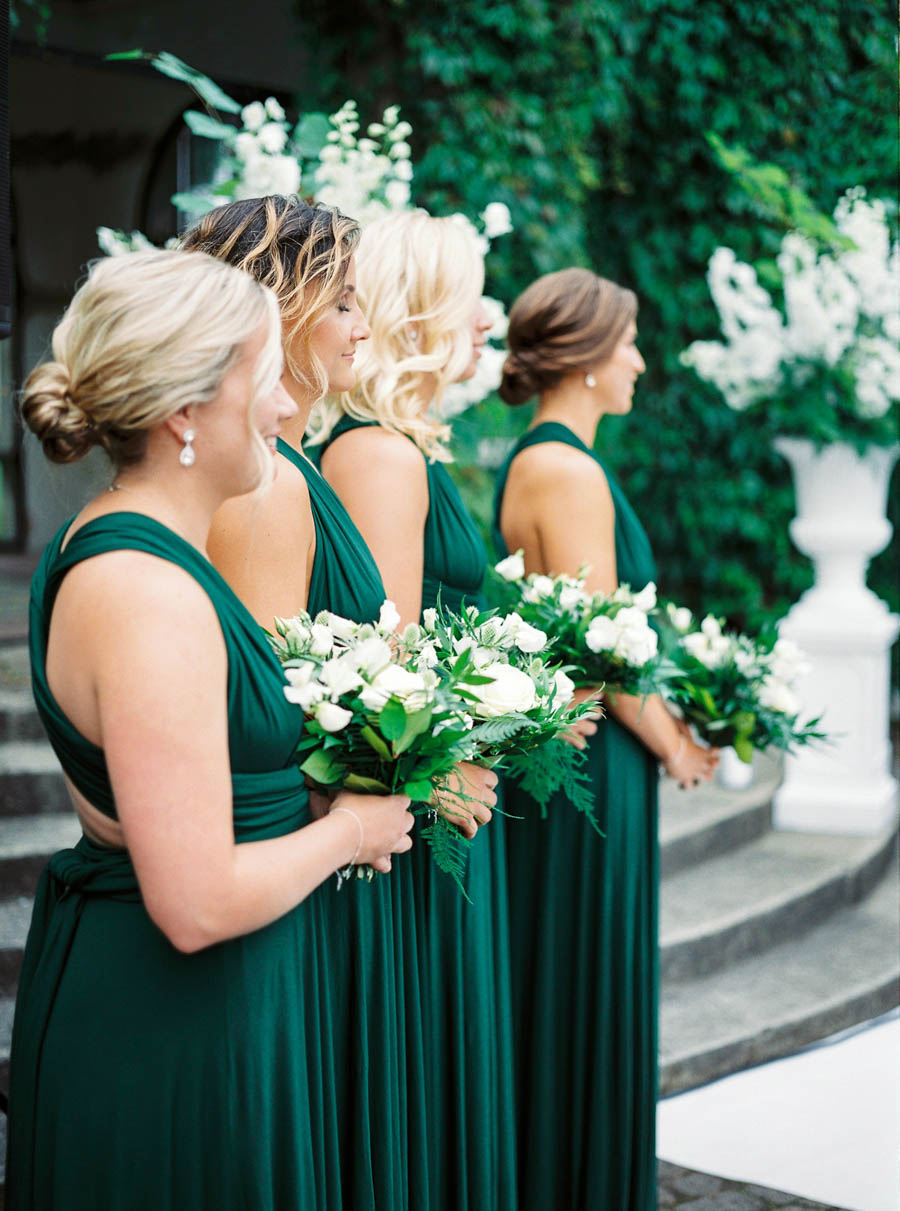 bridesmaids in green dresses and white bouquets